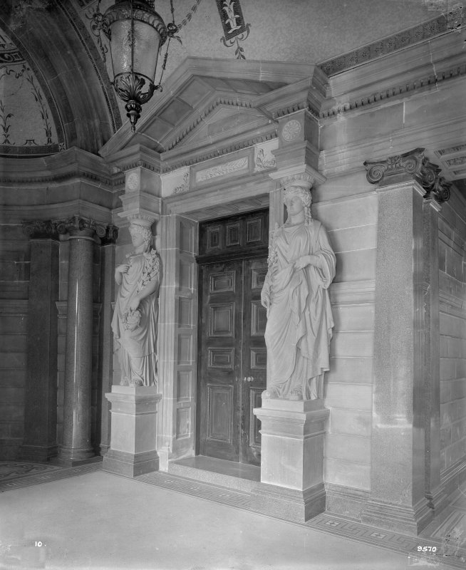 Detail of entrance with statues on either side of doorway