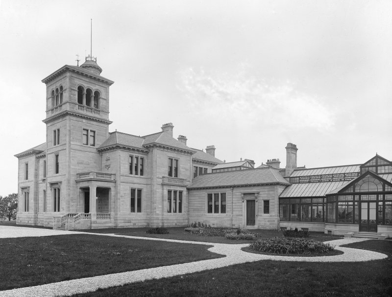 General view of entrance elevation with conservatory to right