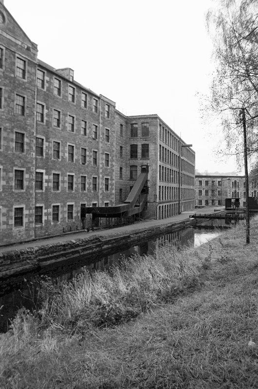 View from E showing NNE and ESE fronts of Mill Number 2 with part of Mill Number 3 on left, Mill Number 1 in background and lade in foreground