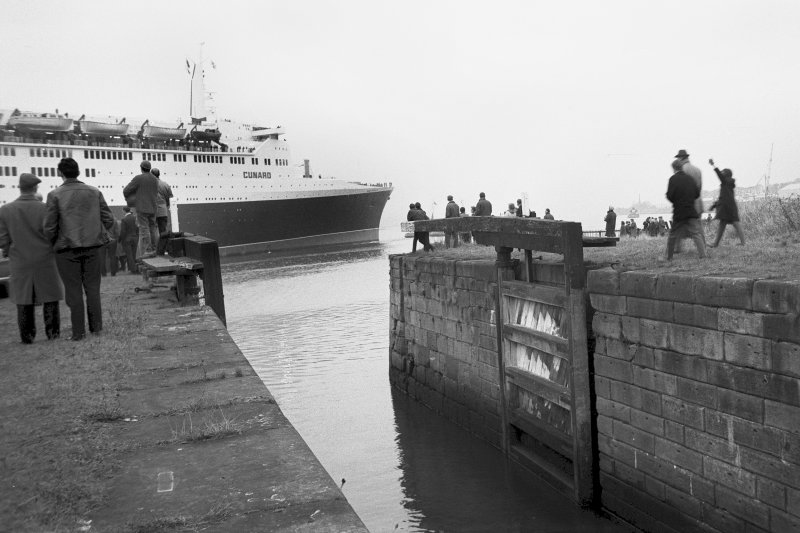 View looking W showing QE II on River Clyde with lock in foreground