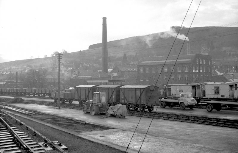 View looking S showing wagons at station with part of mill in background, Galashiels railway station