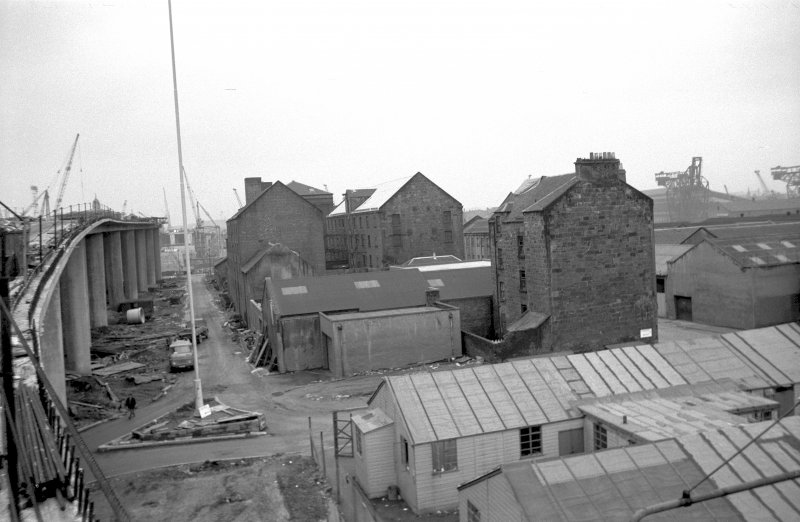 View from NNE showing N and E fronts of numbers 45-49 Cheapside Street with flour mill in background