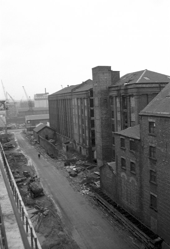 View from NNE showing part of E front of Cheapside Flour Mills with Houldsworth's Mill in background