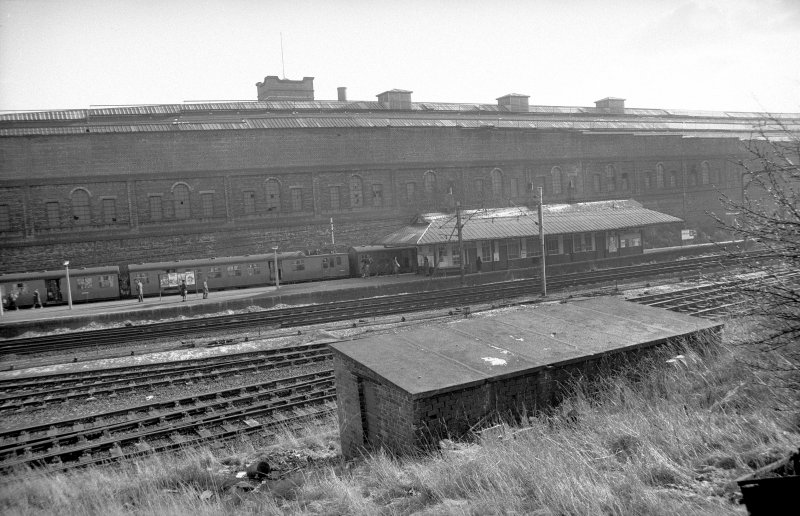 View from NW showing WNW front of station building with part of tram depot in background