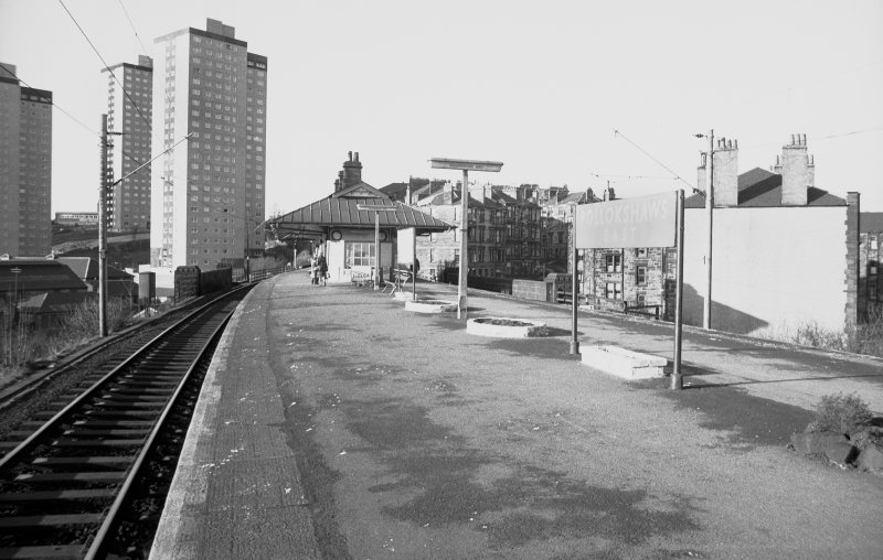 View looking NW showing SE front of station building with tower blocks on left
