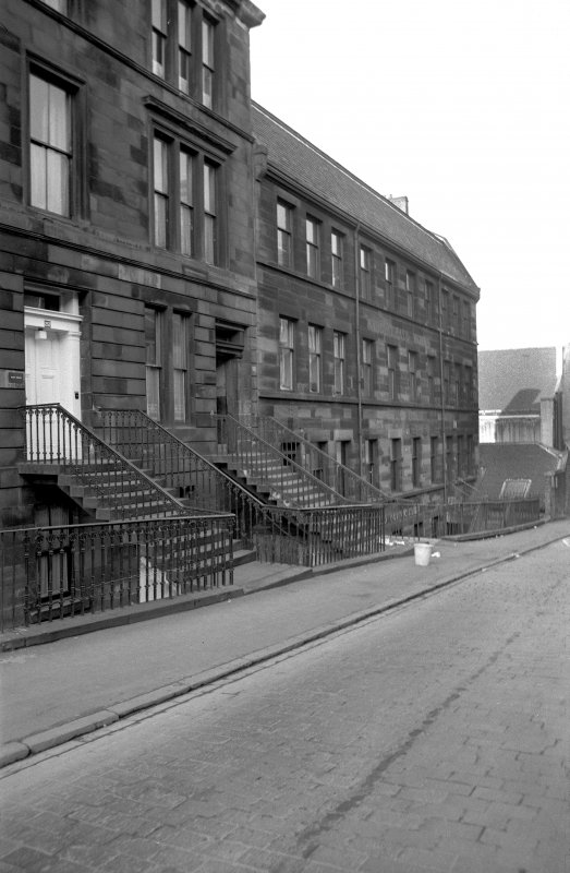 View from E showing NNE front of works with part of tenement in foreground