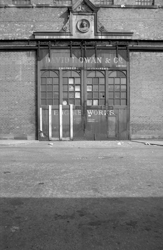 View from WNW showing large ornamental doorway of high single storey block. Rowan and Co Ltd, Elliot Street, Glasgow.