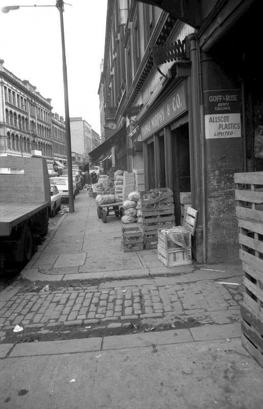 View looking E along Ingram Street with warehouse in background and fruit market on right