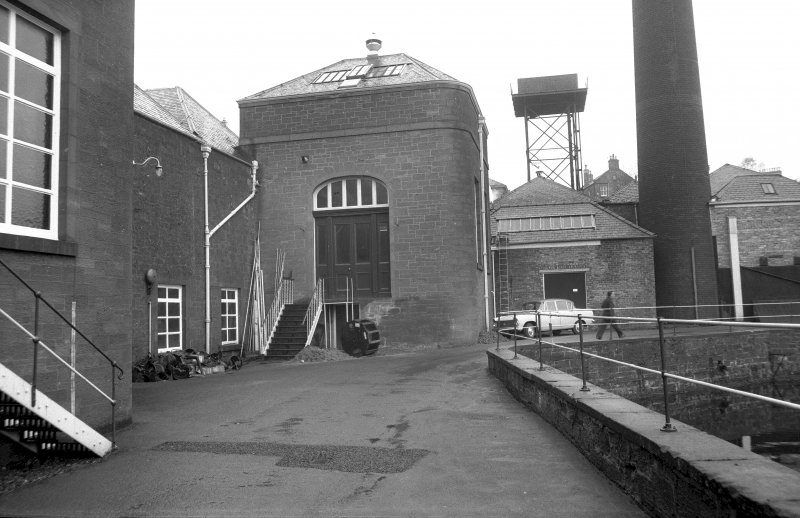 View from SSE showing SSE front of 'old' engine house with part of 'new' engine house on left and base of chimney and part of cooling pond on right