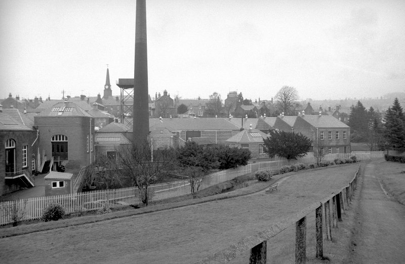 General view from SSW showing chimney with N blocks in right background and 'old' engine house and part of 'new' engine house on left