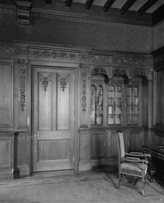 Interior - view of door and bookcase in library