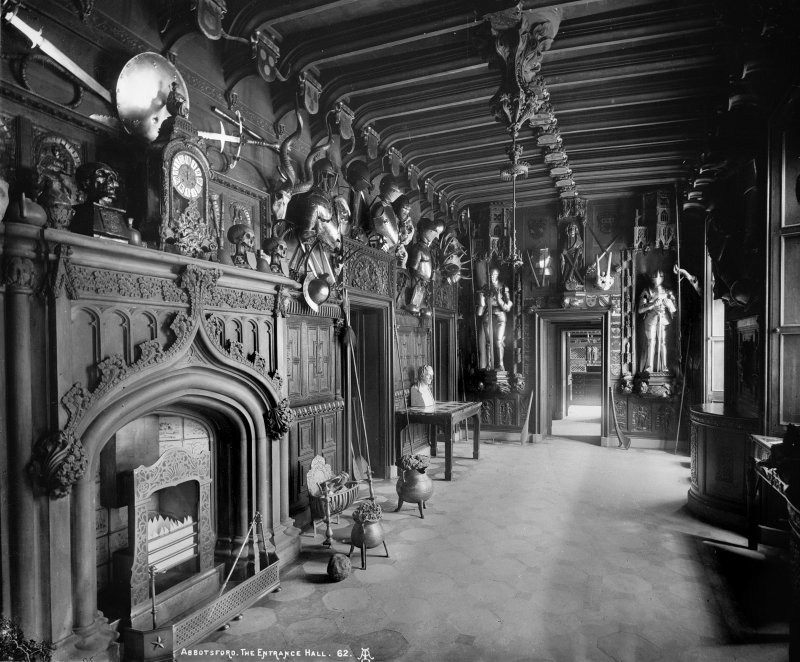 Interior-general view of Entrance Hall showing armoury and fireplace. Digital image of B/66457.