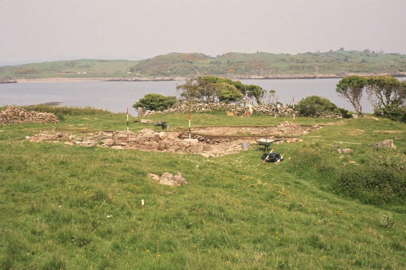 Copy of colour slide showing general view of site from N.W., corners of chapel marked by ranging poles. Ardwall Island, Dumfries and Galloway NMRS Survey of Private Collection Digital Image Only