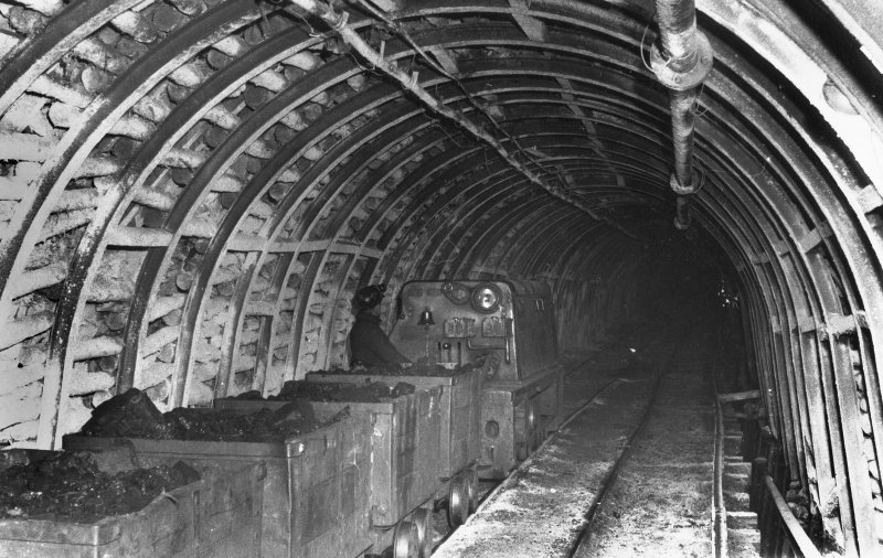 Underground, view of diesel locomotive in West Mine. No date