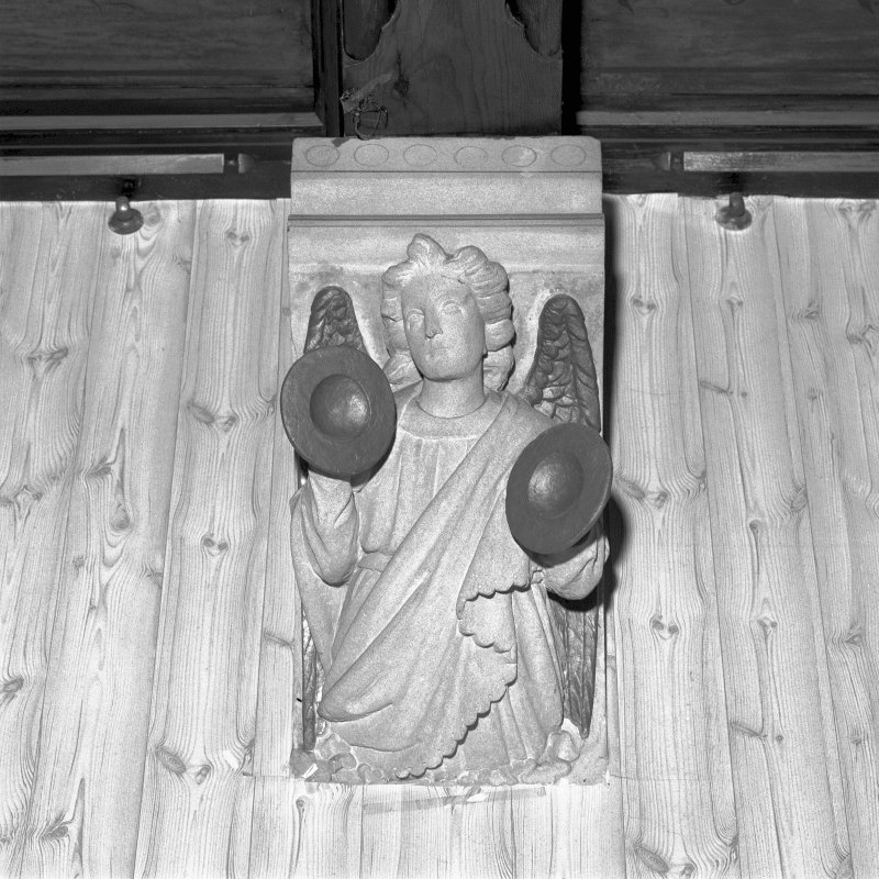 Interior. Detail of carved angel in dining room. Digital image of E 2287.