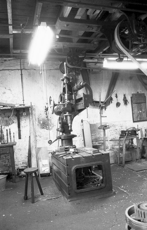 Interior View of millwright shop showing drilling machine