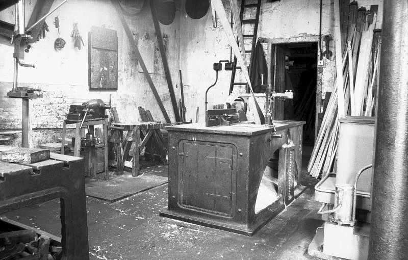 Interior View of millwright shop showing circular saw