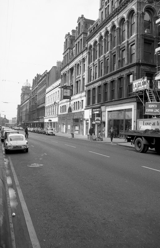 View from NE showing ESE front (Buchanan Street front) of printing works with part of 71-79 Buchanan Street in foreground