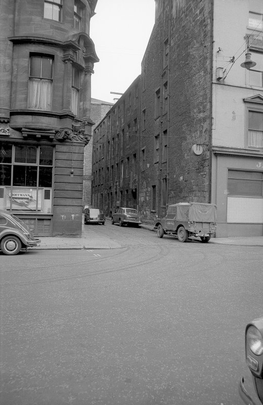 View from ESE showing S front of workshops with part of numbers 77-81 Robertson Street on right and part of numbers 71-75 Robertson Street on left