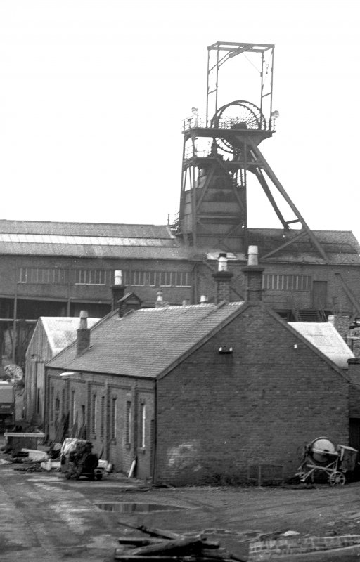 View from SE showing ESE and SSW fronts of E building with headgear of number 7 pit in background