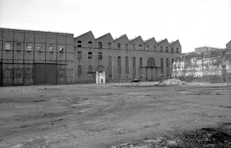 View from SE showing ESE front of engineering works with part of boiler works workshop on left