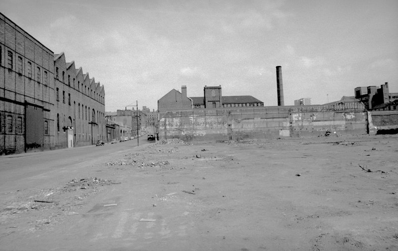 View from S showing ESE front of engineering works with part of boiler works workshop on left