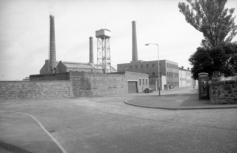 View from NW showing chimneys, tank and part of works