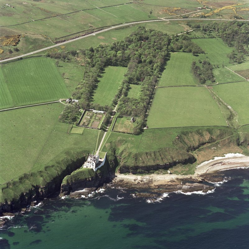 Oblique aerial view of Dunbeath Castle and grounds from E.