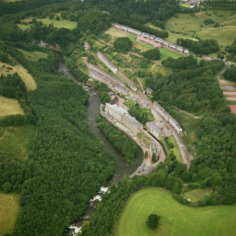Oblique aerial view of New Lanark and the Clyde from South.