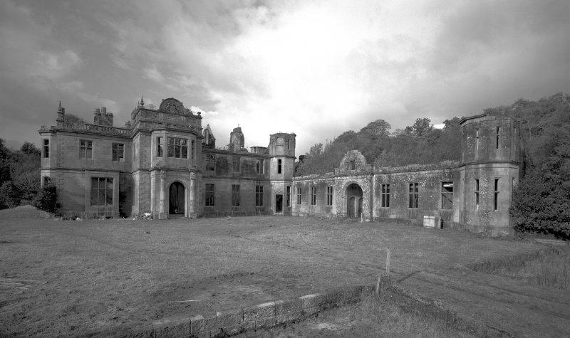 Argyll, Poltalloch House. General view of entrance fromt and stables facade from South-East.