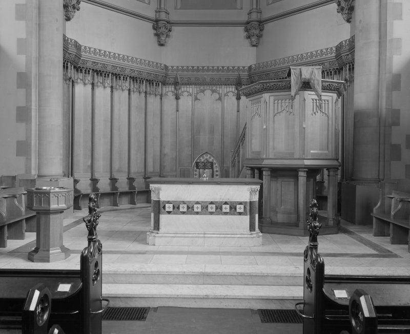 Interior. View of altar showing communion table and pulpit.