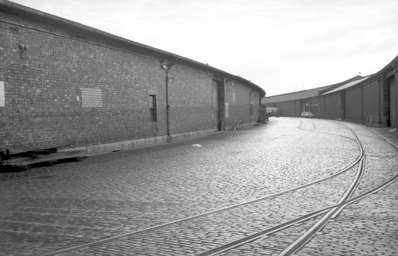 View from WNW showing part of curved SSW front of S goods shed of Queen's Dock with part of Stobcross Quay goods shed on right
