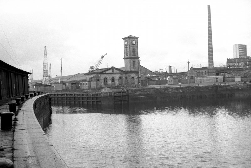 View from SE showing ESE front of west quay with power station in background and part of S quay on left