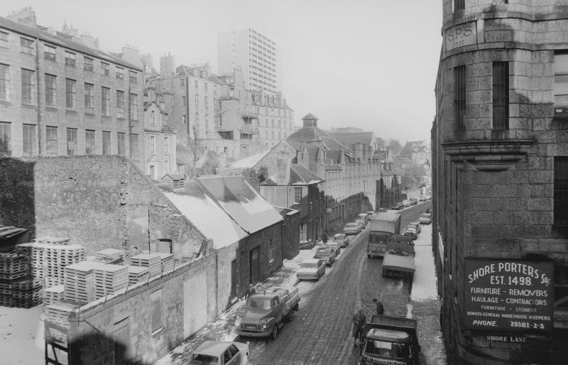 View looking ENE showing SSE front of numbers 17-37 Virginia Street with part of number 12 Virginia Street on right, warehouse/workshop, numbers 23-23 1/2 Virginia Street on left and part of numbers 10-14 Castle Terrace in background