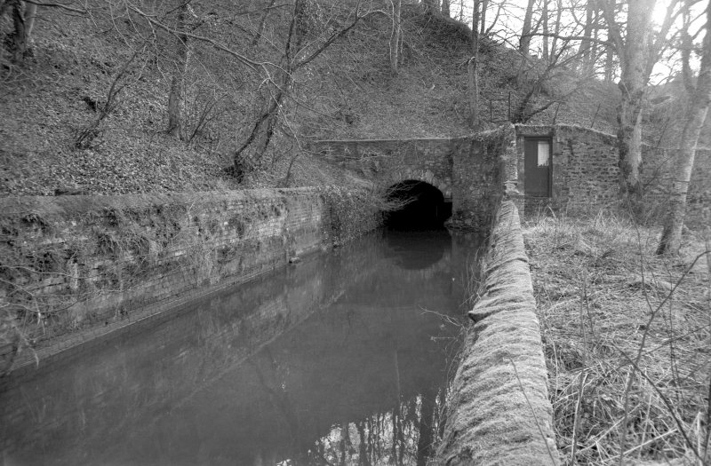 View from NNE showing N entrance to lade tunnel with part of lade in foreground