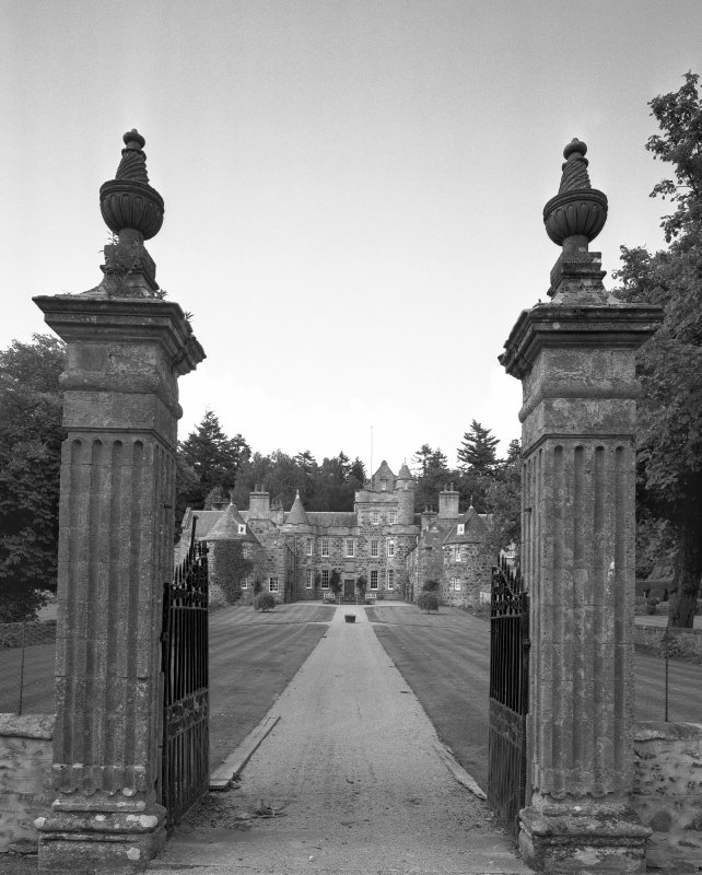 View from South through ornamental gates of garden front