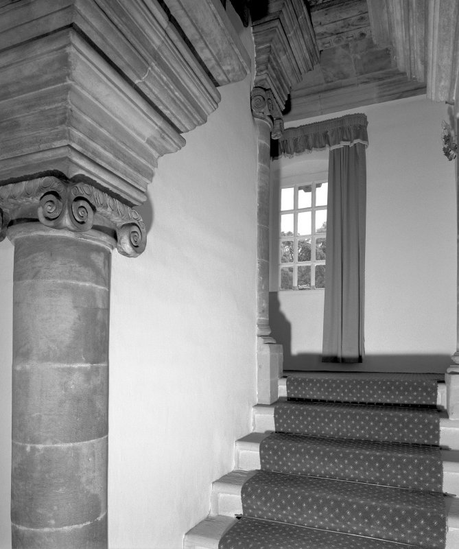Interior. View of East wing staicase showing stone ionic columns, roll moulded steps and ashlar cornice Digital Image of E 7397