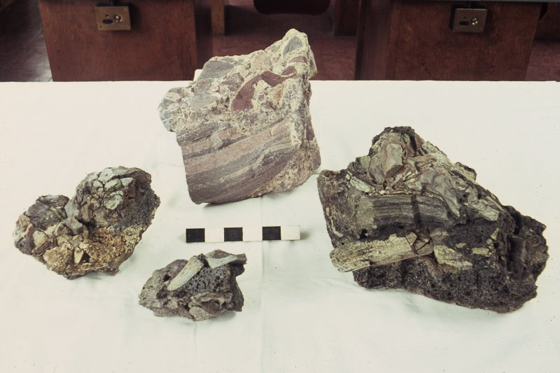 Copy of colour slide showing details of Agglomeratic or Agglutinate types of vitrification. Back: volc. Breccia, Buckstone quarry, Mortonhall Front: vitrification in: Dun Deardail, Nevis;   Meall an Iarnuim, Inverpolly;  Rubh' Aird Ghamsgail  Arisaig. NMRS Survey of Private Collection  Digital Image Only