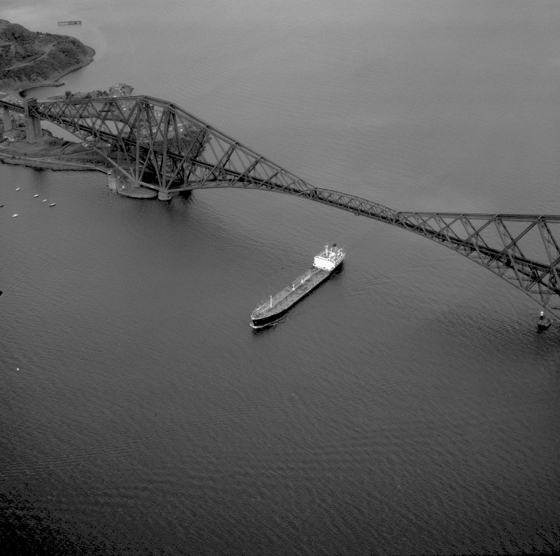 Oblique aerial view from the South West showing a cargo ship passing underneath the bridge. Digtial image of WL 2982.