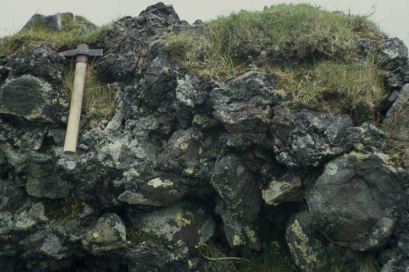"Copy of colour slide showing possible vitrification near Dunnideer. Insc: "" Vitrified mass on N. side near castle. Outer side close up. N.B. line of small horizontal wood casts"" NMRS Survey of Private Collection Digital Image only"