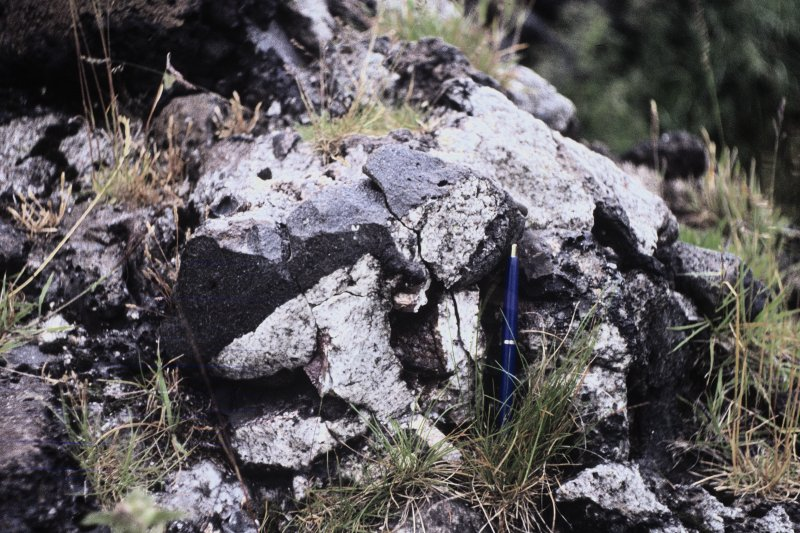 "Copy of colour slide showing possible vitrification near Dunnideer. Insc: "" Detail of vitrified mass on south side - detail of contact between homblendic and granitic rocks"" NMRS Survey of Private Collection Digital Image only"