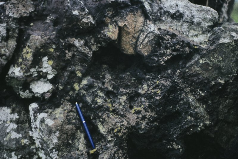 "Copy of colour slide showing possible vitrification near Dunnideer. Insc: "" Detail of vitrified mass on south side, outer side - Detail large wood cast"" NMRS Survey of Private Collection Digital Image only"