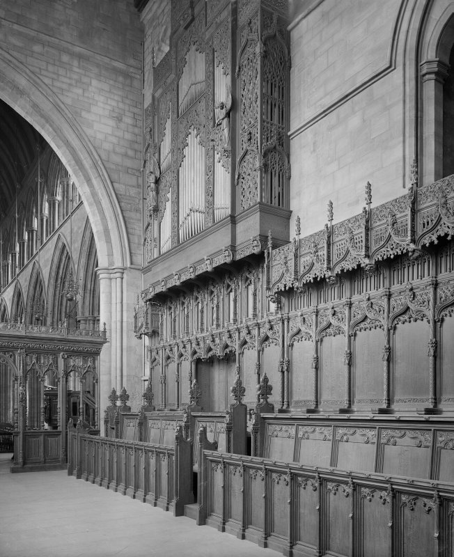 Interior-general view of choir stalls and organ pipes