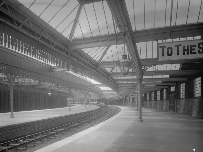 View of the platform at Gourock Station. The cropped sign says 'To the Steamers'.