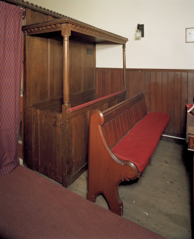 View of interior. Detail of pews, original pannelled oak pew to left