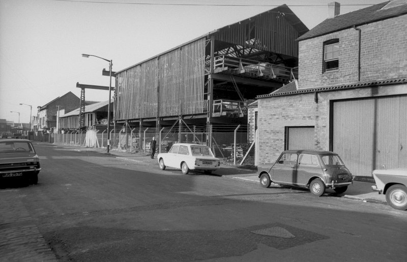General view from SW showing WNW front (Forth Street front) of timber yard with part of joinery works in foreground