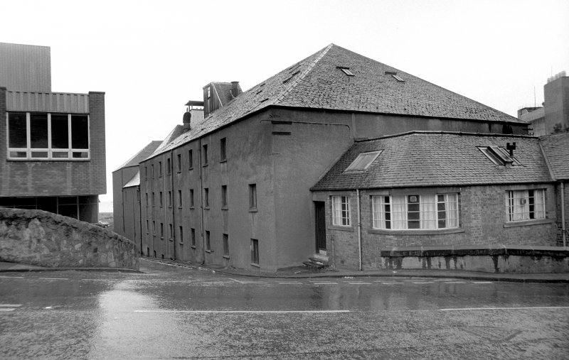 View from NW showing NNE front and part of WNW front of central blocks of Harbour Maltings