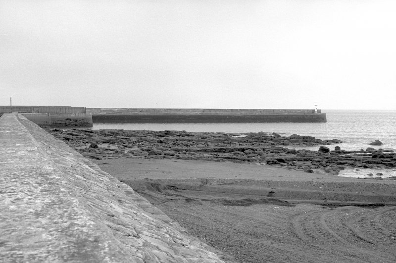 View from NW showing WNW front of breakwater