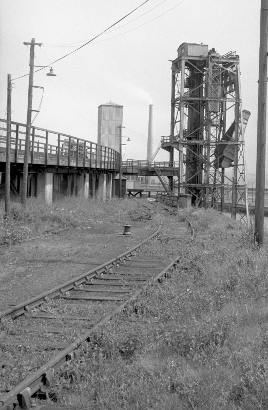 View from SW showing part of SSW front of SW coal drop with railway tracks in foreground