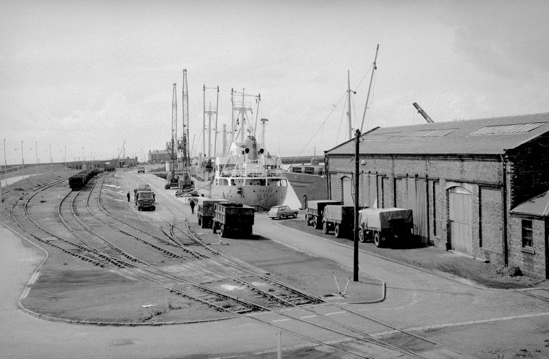 General view looking SSW showing railway tracks on harbour with goods shed to the N of number 1 dock on right